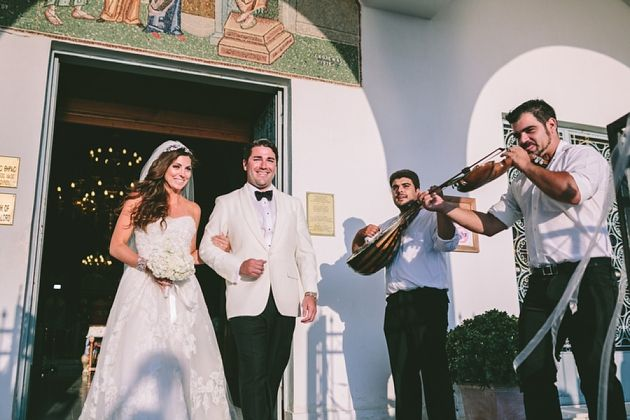 Greek Musicians announcing the newlyweds by Stella And Moscha Wedding in Santorini