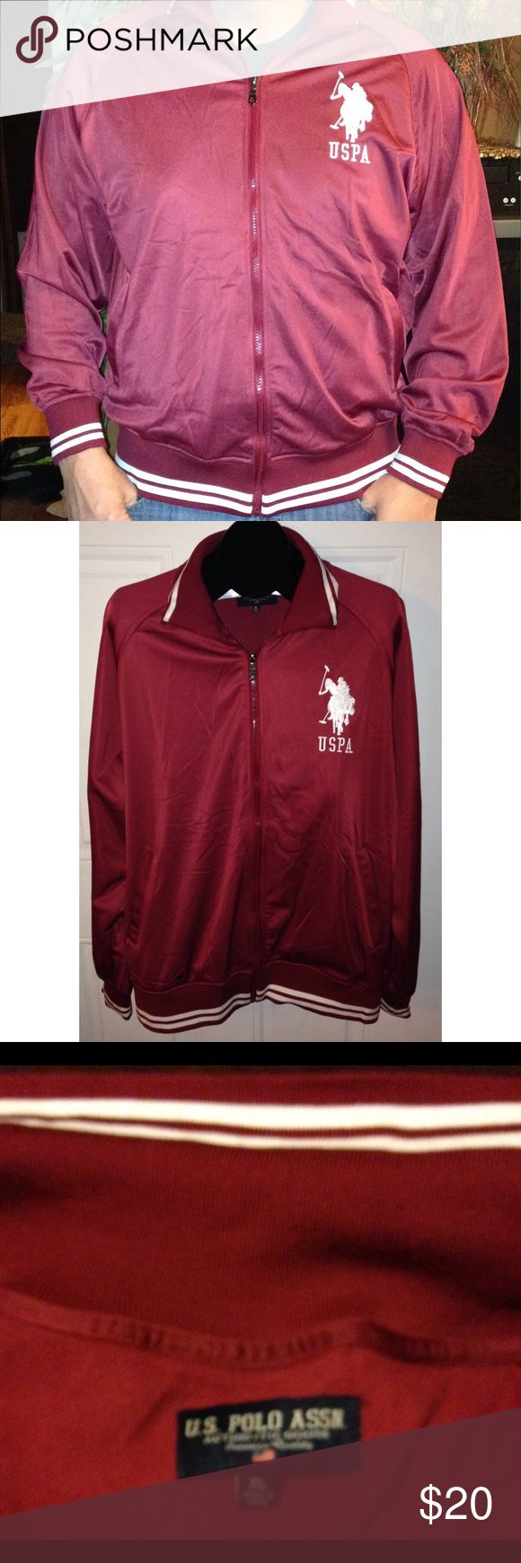 """Men's United States Polo Association Jacket This is a men's burgundy United States Polo Association Jacket. It is an XL with measurements: pit-pit:25"""" and top-bottom: 31 1/2"""". It is 100% polyester. It is in great condition. Jackets & Coats Bomber & Varsity"""