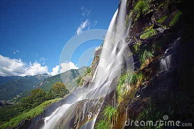 The first leap of Acquafraggia waterfall, from mountains above Piuro, shortly after Chiavenna. Shooting long exposure to capture the layer of water that shone above the vegetation and rocks gives colors a special brightness.
