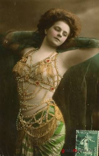 Vintage tinted postcard of a girl in an exotic belly dancer outfit, c.1920s