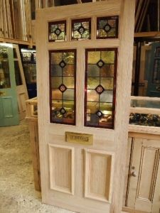 Victorian Style Stained Glass Front Door - use to replace library windows. add 2 long narrow windows to each side for more light