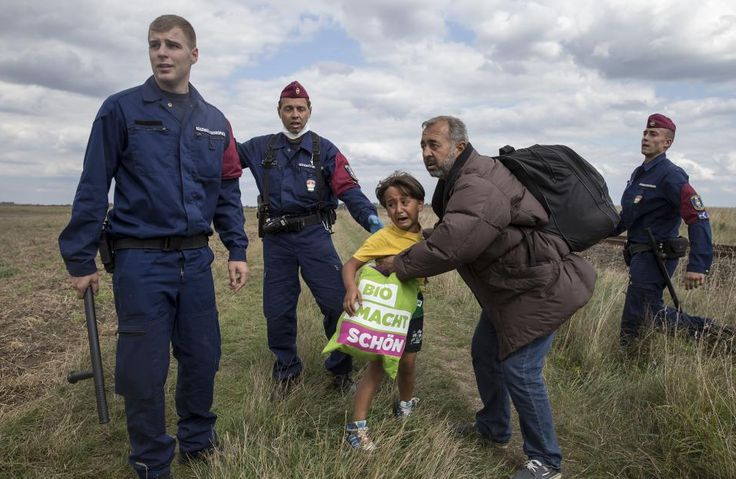 Hungarian camerawoman intentionally kicking, tripping refugees
