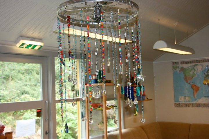 """Threaded beads on a bicycle wheel - image shared by Early Years Learning ("""",)"""