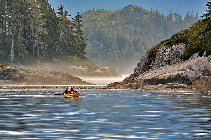 Kayakers paddling the coastal wilderness: Orca Dreams offers kayaking, whale watching and luxury camping on Compton Island, Blackney Pass, British Columbia