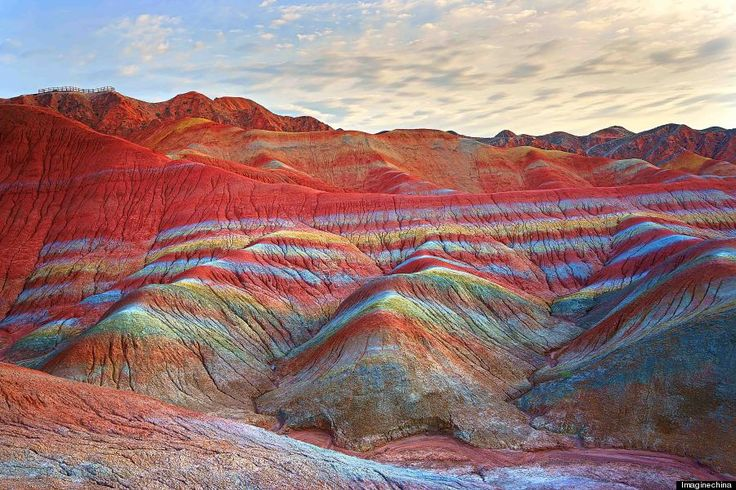 rainbow mountains-The mountains are part of the Zhangye Danxia Landform Geological Park in China. Layers of different colored sandstone and minerals were pressed together over 24 million years and then buckled up by tectonic plates, according to the Telegraph.