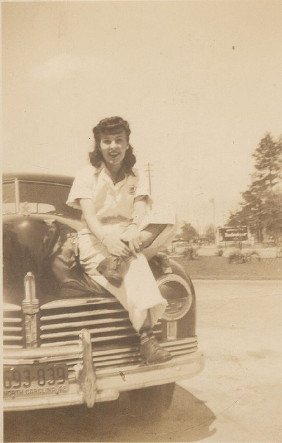 Mom,19 years old, sitting on car somewhere near Camp Lejuene, NC in the spring o…