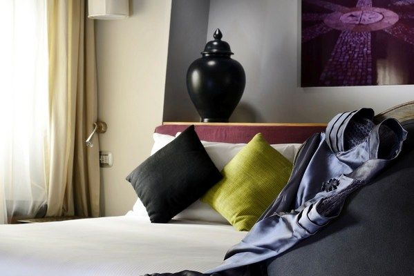 Mario de' Fiori 37 in Rome, Italy - Studio Deluxe: The suite features a king-size canopy bed with Frette sheets.
