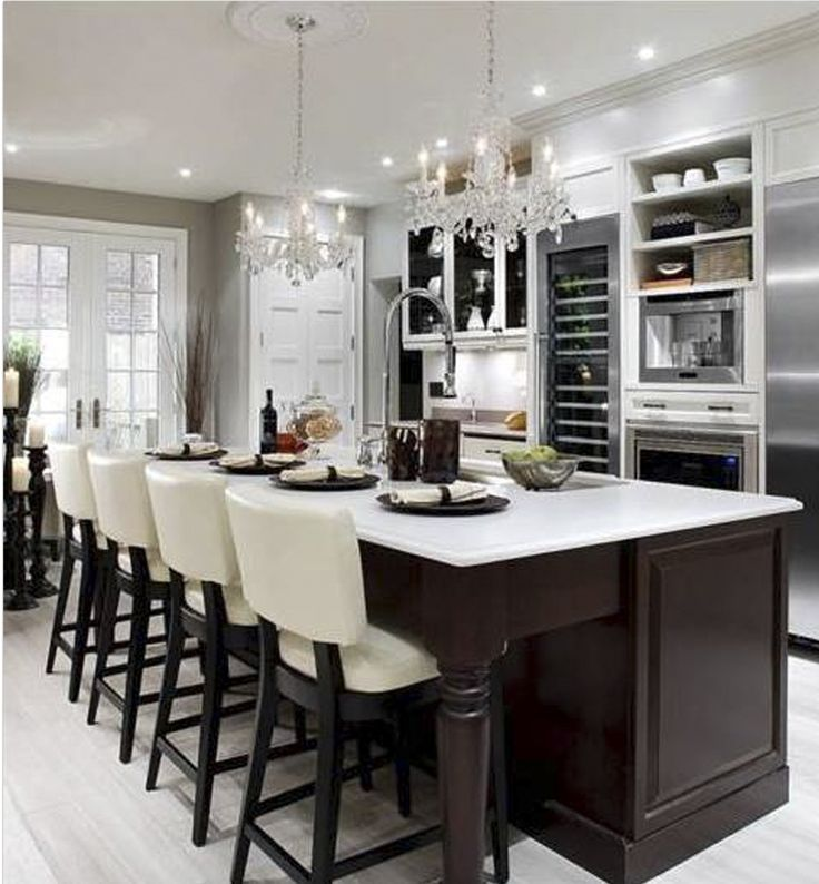 Elegant Kitchen Design With Cream Leather Barstools, Double Crystal  Chandeliers, Chocolate Brown Stained Kitchen Island, White Quartz Counter  Tops, ... Part 75