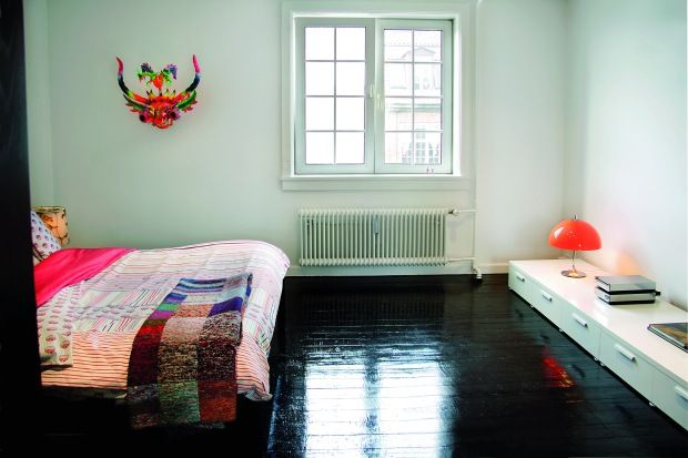 amazing glossy black wood floors. put down cheap wood flooring and paint it.