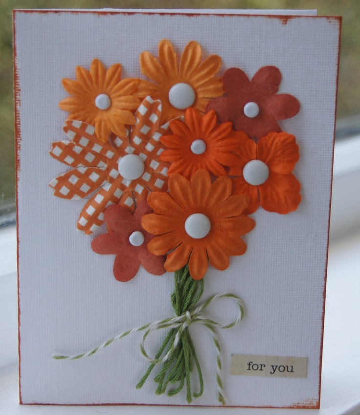 What a great idea to use coordinating flowers...make fake 'brads' with punched circles and it'll be mailbox friendly!