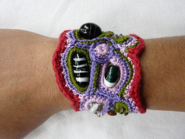 A personal favourite from my Etsy shop https://www.etsy.com/uk/listing/130422686/free-form-crochet-bracelet-glass-beads
