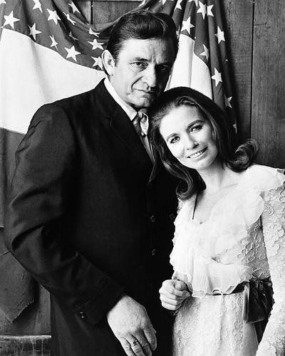 Johnny Cash June Carter posing with American flag 16x20 Poster  Premium quality printed on archival double weight paper  16x20 inches (40x50 cms)  Unique collectible cinematic art  Perfect for your home, cinema room, office or dorm!