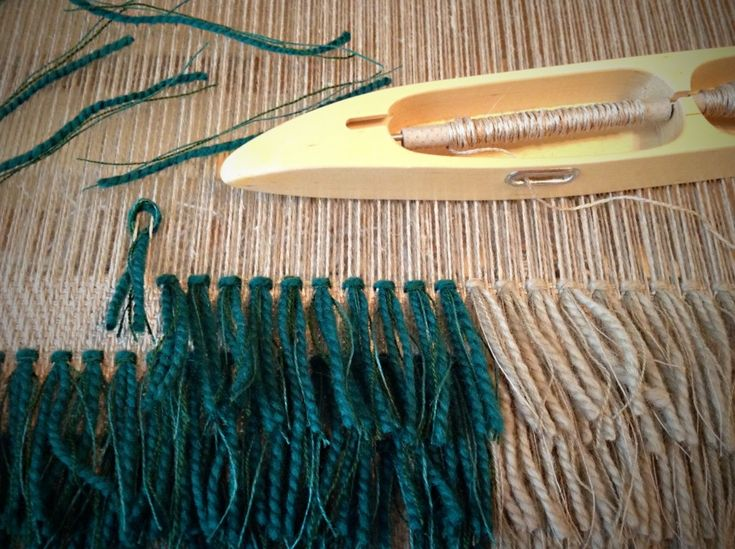 Forming rya knots in coarse linen fabric.