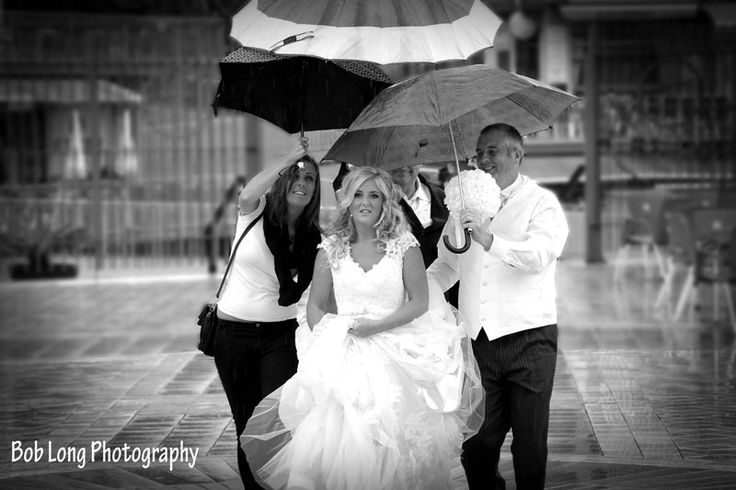 The rain will not stop up!! Flash storm didn't spoil this bride's day