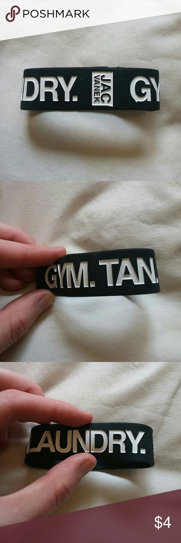 Jac Vanek brand rubber bracelet New and never worn. Black rubber bracelet from Jac Vanek. Reads: Gym. Tan. Laundry. Jac Vanek Accessories