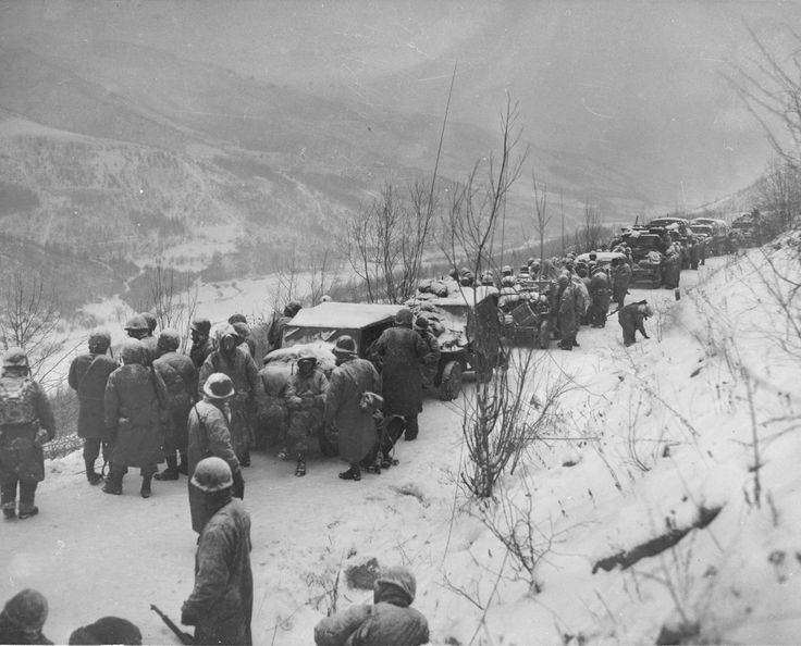 Astonished Marines of the 5th and 7th Regiments, who hurled back a surprise onslaught by three Chinese Communist divisions, hear that they are to withdraw. In five days and nights of below-zero winds and icy roads, from Nov 28 to 3 Dec, they fought back 15 miles through Chinese hordes to Hagaru-ri, on the southern tip of Chosin Reservoir, where they reorganized for the epic, 40 mile fight down mountain trails to the sea. They brought out their wounded and their equipment.
