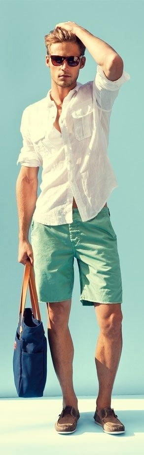 Perfect summer outfit: you can't go wrong with a simple white linen shirt, shades and mint (!!) green chino shorts.