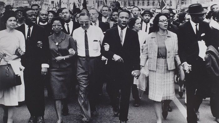 """""""Rosa Parks (L), Dr. and Mrs. Abernathy, Dr. Ralph Bunche, and Dr. and Mrs. Martin Luther King, Jr. leading marchers into Montgomery, 1965."""""""