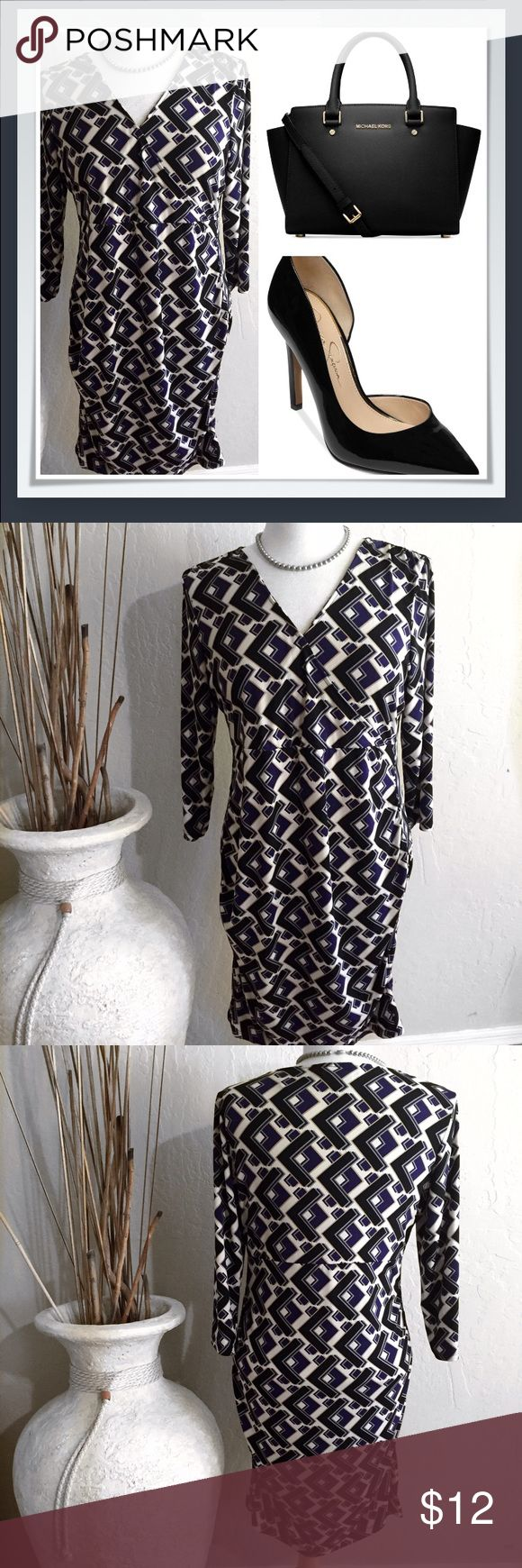 """Black Purple Chevron Rugged V-Neck Dress size L CALKING ALL CURVIES!  This dress is going to make you look like a Jenniffer Lopez! V-Neck, 3/4 sleeve, and rugged skirt for figure definition!  Poly/spandex blend for a soft and light feel. Easy to style for different looks.  Bust 20"""", length 37"""". Attention Dresses Midi"""