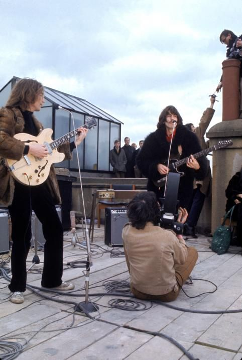 Filming from the Rooftop at Apple offices- one last time. On 30th January 1969, The Beatles (with Billy Preston) played their farewell gig on top of the Apple offices at 3 Savile Row.