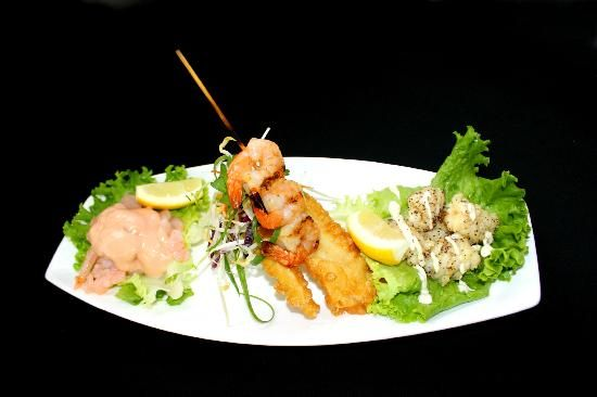 Must try the Seafood Plate at Legends Restaurant in Paihia, New Zealand.