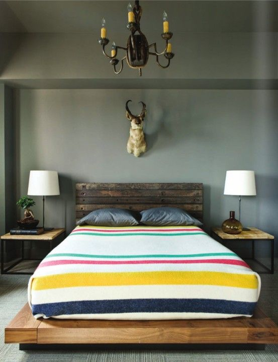 Don't like the dead animal head -- but love the southwestern style and wood bed frame.