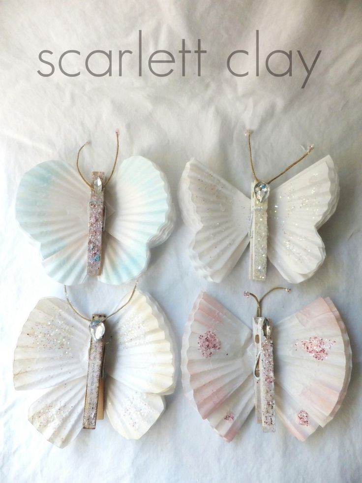 Tutorial: butterflies made w/cupcake liners, clothes pens, twine, glitter & bling. Very angelic.  - bluepurpleandscarlett blog