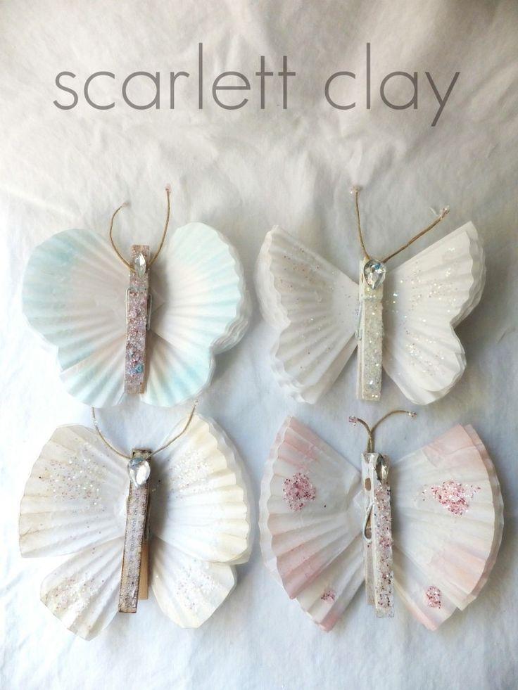 Tutorial: butterflies made w/cupcake liners, clothes pens, twine, glitter & bling. Very angelic.  - bluepurpleandscarlett blog