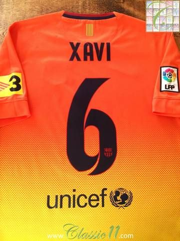 9ff3dcd5282 Official Nike Barcelona away football shirt from the 2012 13 season.  Complete with Xavi  6 on the back of the shirt and La Liga patch on the  sleeve.