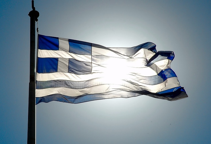 Greek flag! The nine stripes represent the nine syllables of the phrase Eλευθερια η Θάνατος (freedom or death). Colors white for freedom & blue for the Greek blue sky.The cross is the symbol for the orthodox christianity >!