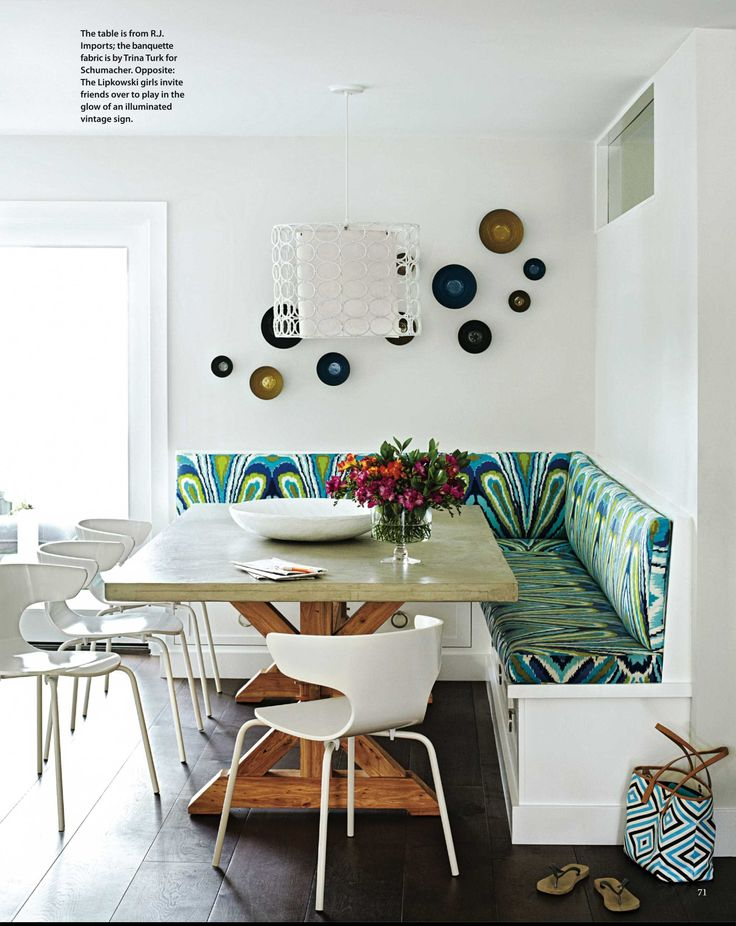White and tropical fabric makes a jolly dining corner