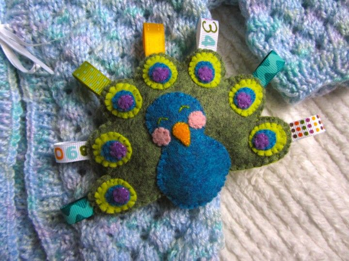 Felt Peacock Baby Rattle @Imagine Our Life: This sweet little guy came about because I needed a gender-neutral baby gift and I wanted to try out some of the new colors of felt available from American Felt & Craft. Plus, it was a great excuse to use some of the cute ribbon scraps I've been collecting. I wanted to choose something that isn't typically made into toys. Owls are SO trendy right now, but it's time to give some other birds a little love! So, allow me to introduce you to Mr Peacock!