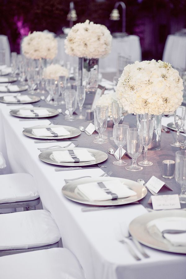 Silvers and whites combined to create a beautifully elegant table setting, perfect for a marquee celebration.