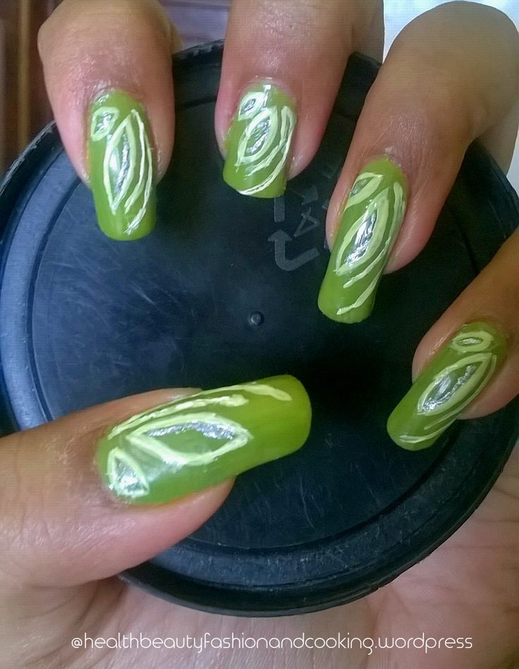 Nail art using green, white and sparkle polish