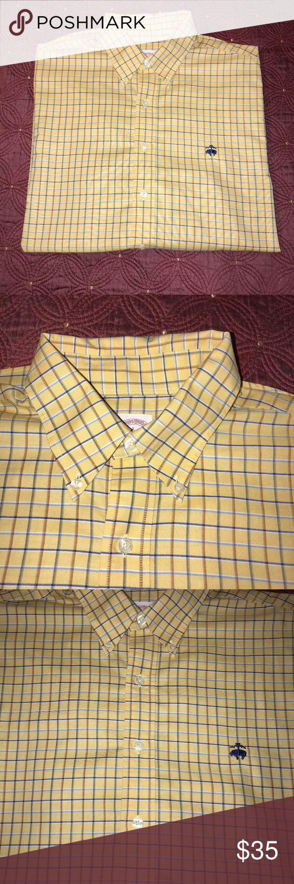"""Brooks Brothers L Yellow Plaid Long Sleeve Shirt This is a very nice Brooks Brother large long sleeve plaid shirt. It is made out of supima cotton.It is in amazing condition. Looks just like new. Has no flaws what so ever. It is a traditional fit and is a non-iron shirt. I am not quite sure if it is a regular or big & tall shirt, so please look at measurements.   Measurements (taken on flat surface): Pit to pit: 26"""" Length: 30"""" Shoulder and Sleeve: 32""""  If you have any questions or need more…"""
