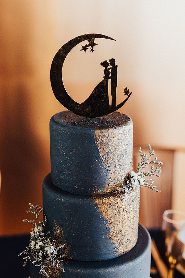 The sparkling cake by Sweet Cravings is seriously divine. And we're over-the-moon for that cake topper. Over. The. Moon. Photo by Fox + Sloane Photography #utahvalleybride #utahwedding #utahweddingphotography #starweddingcake #starweddingtheme #starrywedding #uniqueweddingcake #bluecake #blueweddingcake #winterwedding