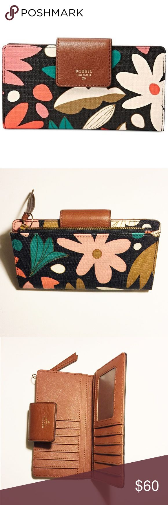"""NWOT Fossil Sydney Tab Wallet in Dark Floral Fossil Wallet, new without tags!   Zip pocket on back in gold with brown leather pull   Top flap snap double closure  Four large slot for bills, three slip pockets, twelve slots for cards, a clear ID holder and is fully-lined with brown PVC & brown fabric lining  Approximate measurements when closed: 6.8""""L x 3.75""""H x 1""""D  FOSSIL leather logo on leather tab on front Fossil Bags Wallets"""