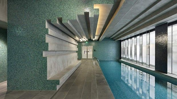 Sebel Docklands, Melbourne. Indoor lap pool with fully tiled interior. Love the moulded concrete detail and tile. Pinned to Pool Design by Darin Bradbury.