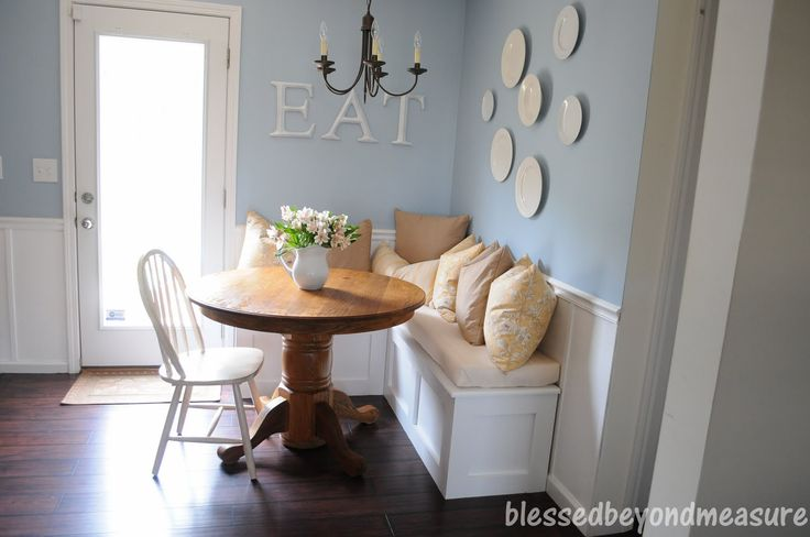 Love this small kitchen eat-in area; breakfast nook.