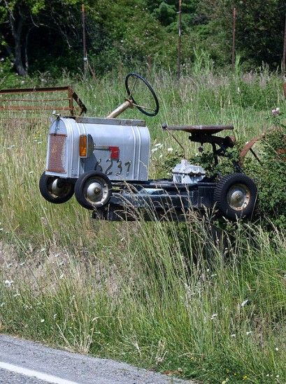An old go-kart that looks like a mini tractor? Turned into a mailbox, complete with a flag indicating whether or not you've got mail?