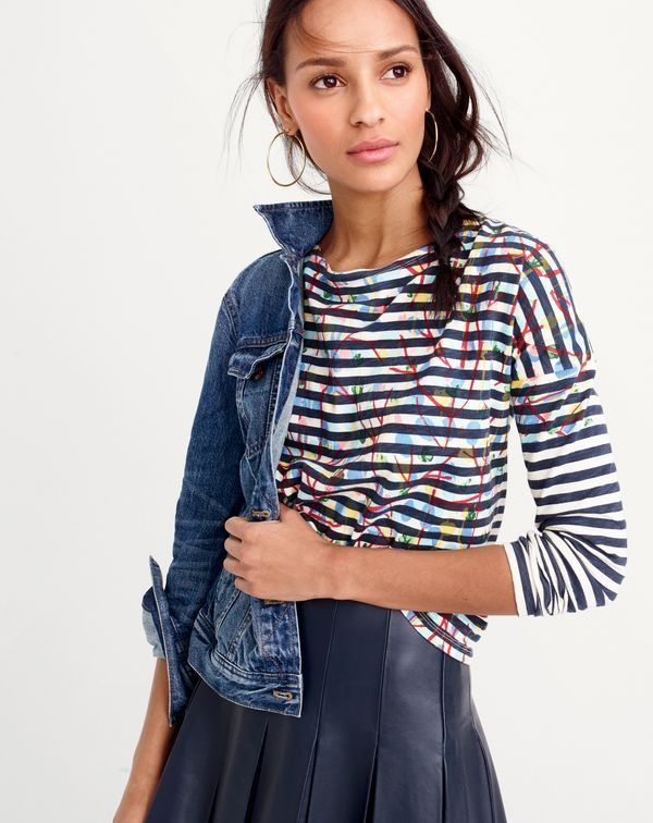 Michael De Feo for J.Crew striped T-shirt with painted flowers, J.Crew women's denim jacket in Newton wash, Collection leather skirt with drop pleats, and antique-gold hoop earrings.