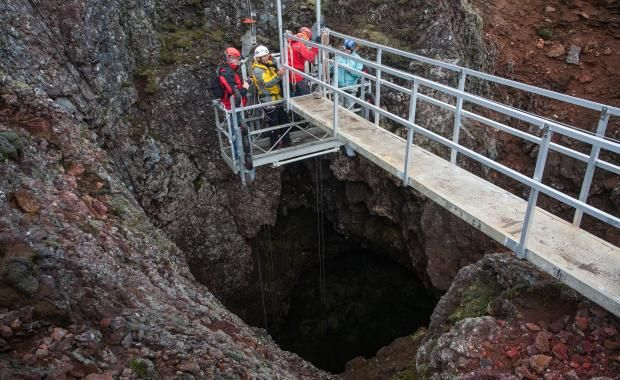 Travel with a lift deep inside the empty magma chamber of a volcano