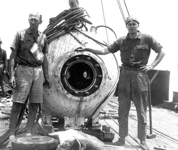 William Beebe and Otis Barton with bathysphere after dive off Bermuda in 1934.