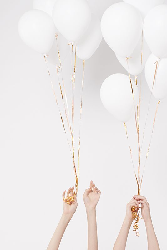 white balloons + gold ribbons