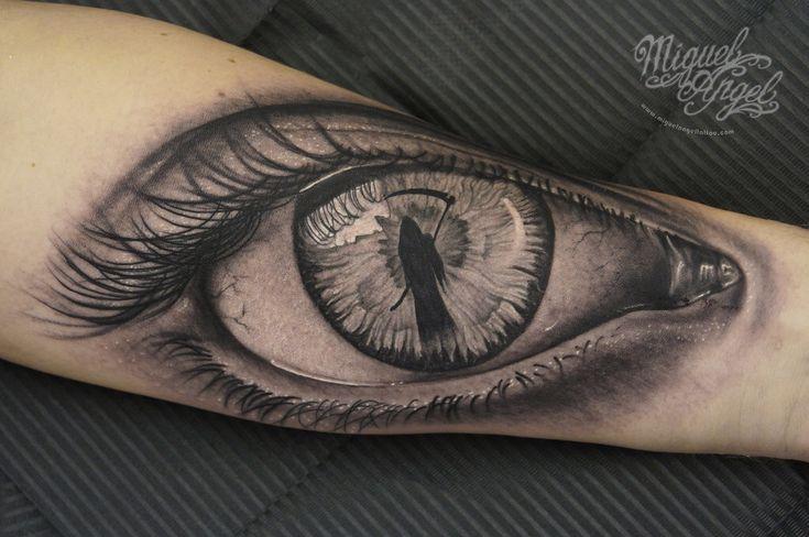Eye with grim reaper tattoo