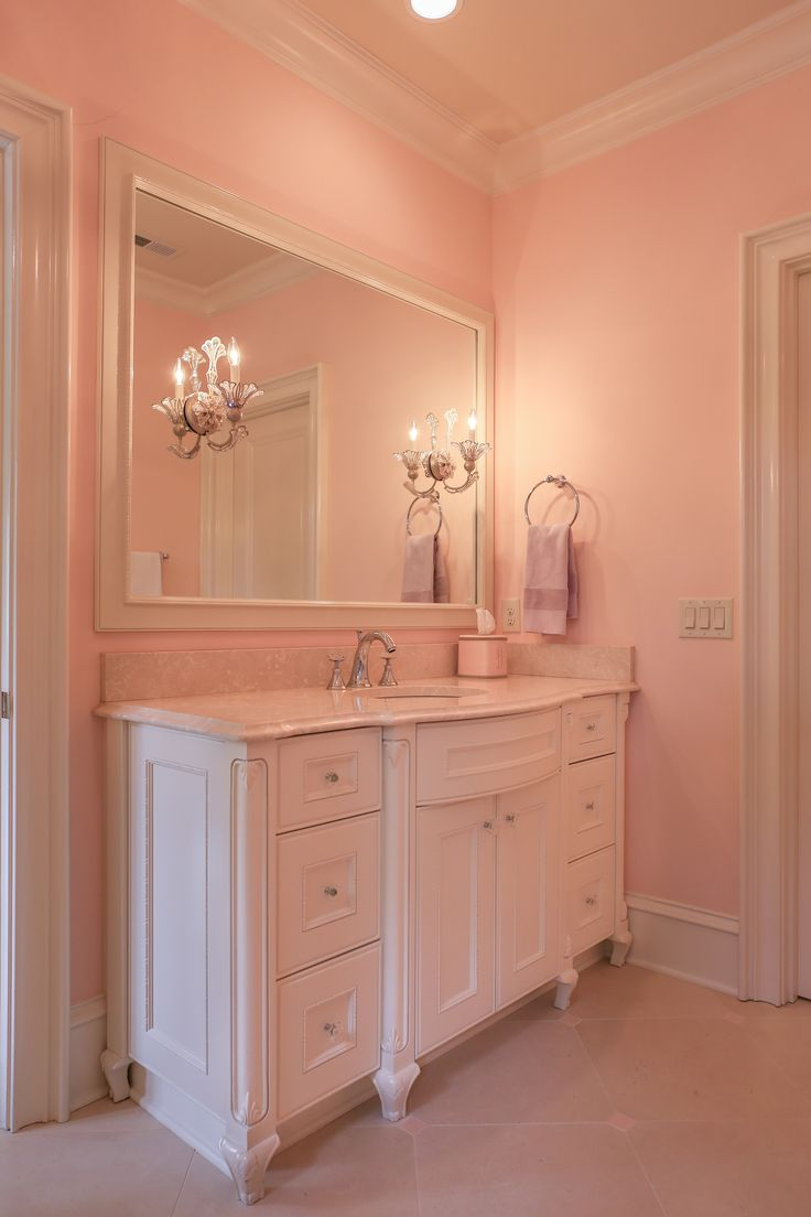 Little Girl's Bedroom + Bathroom | www.designsbydurham.com | www.livengoodphotographs.com | Every little girl needs a space to grow and flourish into a young lady. | bathroom · bathroom lighting · bathroom sconce · bathroom vanity · botticino marble · custom lighting · feminine · filigree · girls bathroom · kids bathroom · little girls bedroom · marble countertops · mirror sconces · pink · pink paint · Renaissance Tile · schonbek lighting · sconces · traditional · Walker Zanger Tile