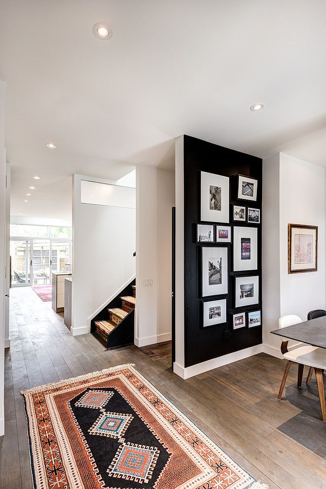 Rug and black accent wall