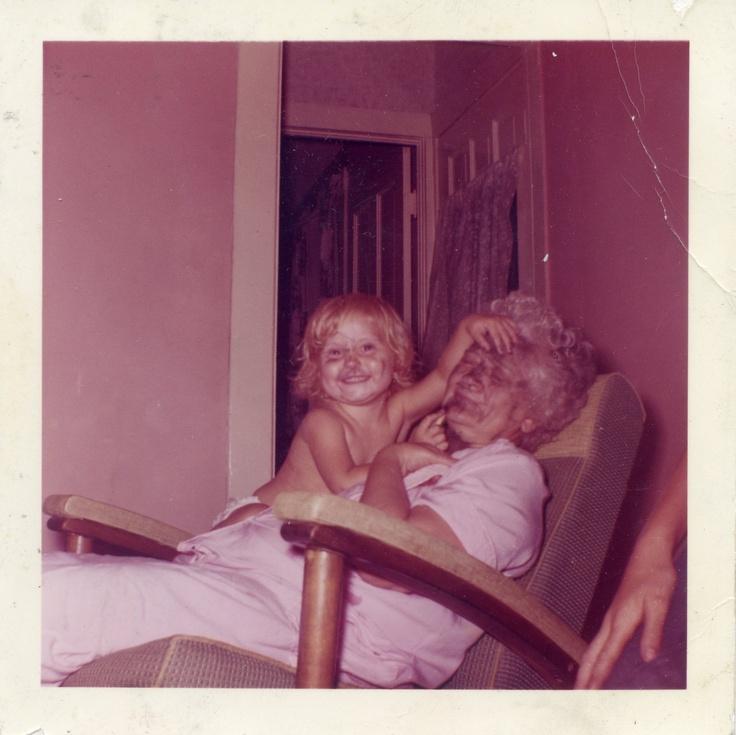 Putting makeup on grandma.