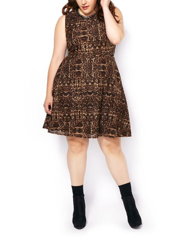 """Take on cooler weather in cool style with this lovely plus-size dress! Its fit and flare design creates a beautiful feminine figure. It also features a rounded neck and bold, trendy print. Make it chic with heels or give it an edge with booties and a jean jacket! Length: 40"""""""