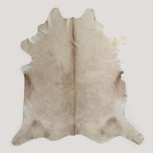 Light Natural Cowhide Rug. Also looking for brown/white or black/white cowhide rug.
